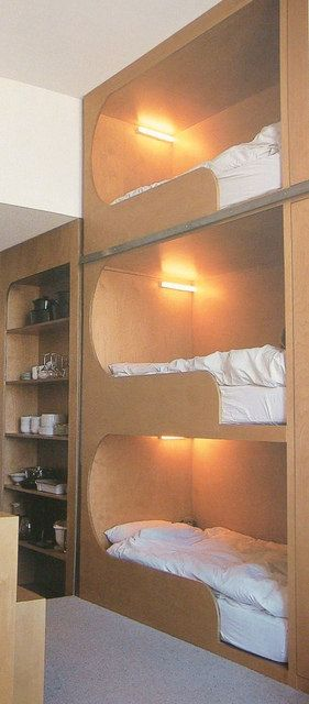"""Bunk Beds - Apparently we aren't the only ones to have discovered """"Triple Bunks""""    When it comes to guest accommodations, there's always bunk beds, and this vertical design makes use of the available space all the way up to the ceiling."""