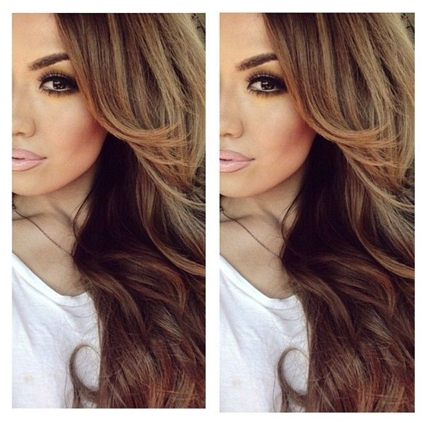 Chocolate brown hair with caramel and honey highlights...accentuated with lots of layers.I like her make up too