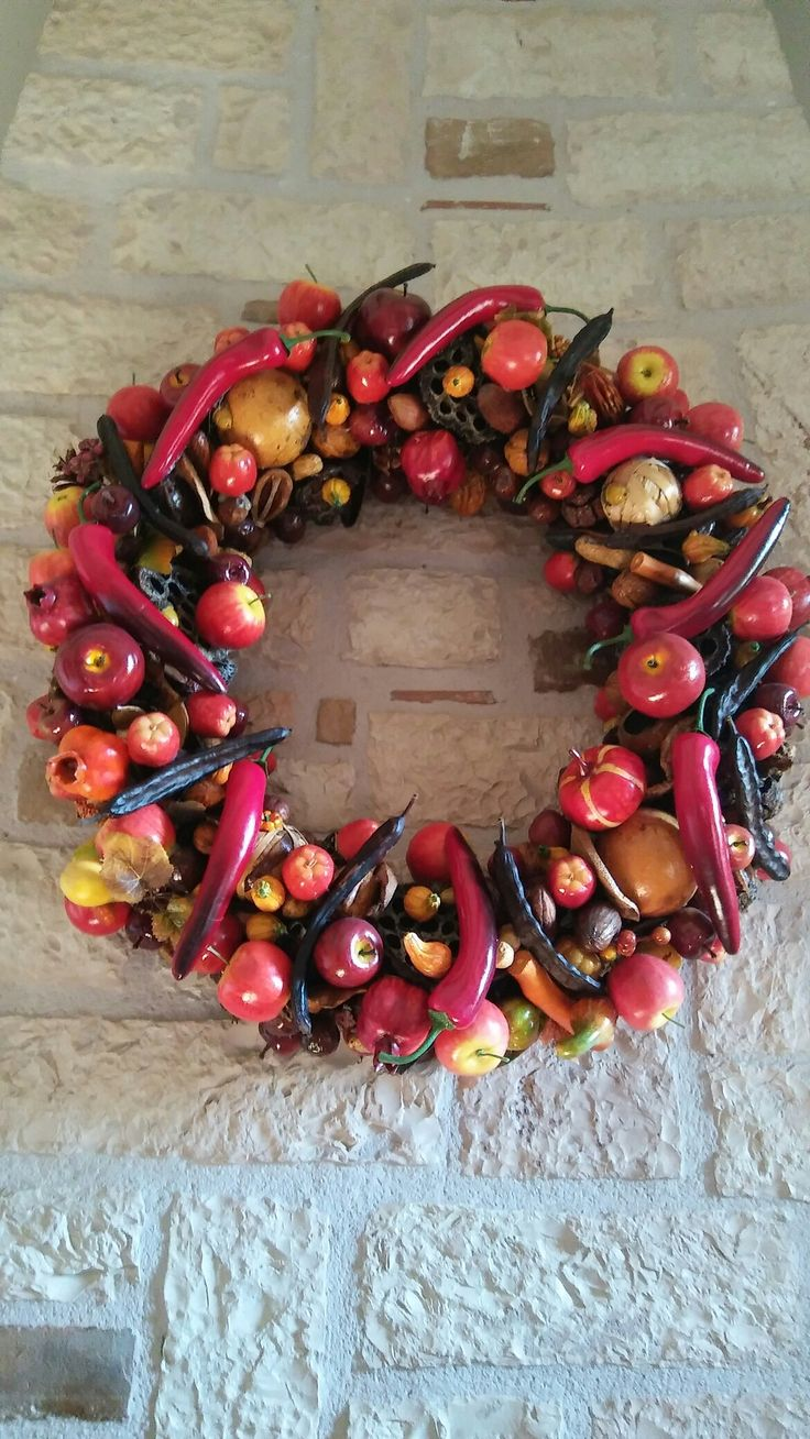 A wreath for my mantle made years ago.Every year I add some more fruits either real dried or artificial ones.