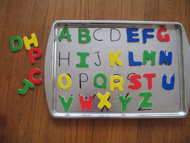 Write the alphabet on a cookie sheet, provide magnetic letters to match - I Love this idea!