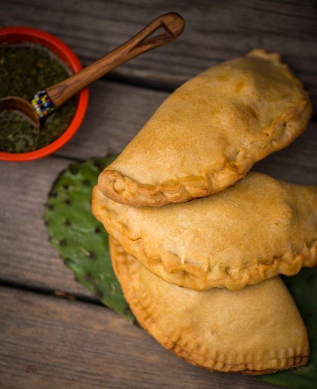 Empandas. Cumin seasoned meat, enveloped in a tender golden crust with an international flare.