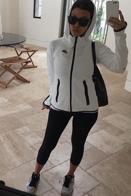 Kourtney Kardashian wearing Saint Laurent Square Sunglasses, Nike Tech Fleece Hoodie and Apl Techloom Pro Sneakers in White/Black/Cosmic Grey