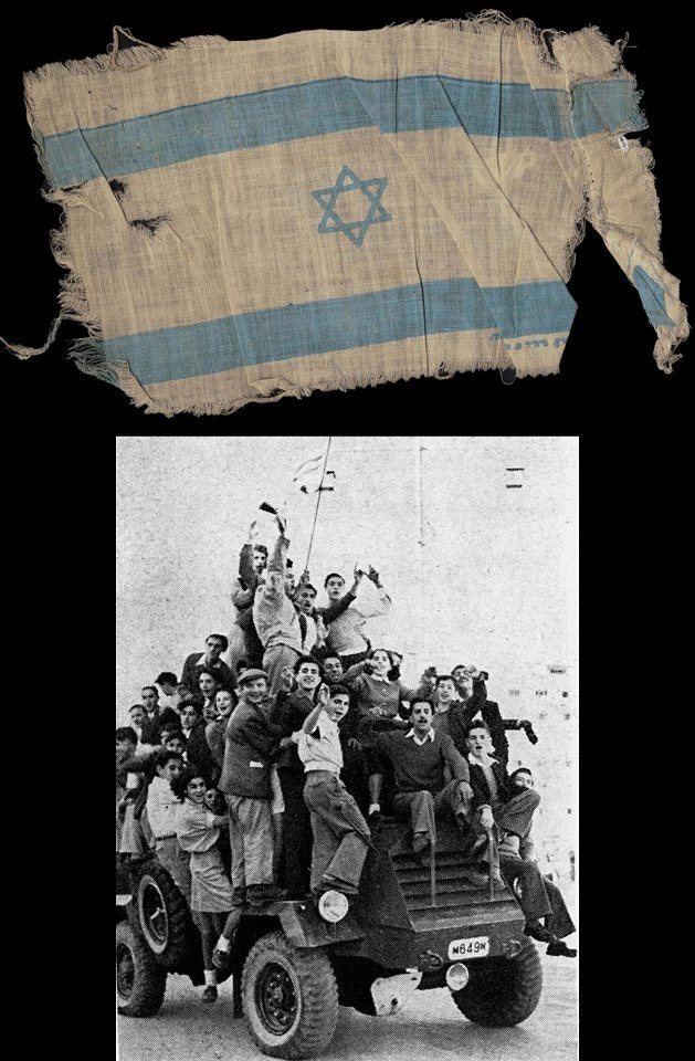 Eleazar (Spiegel) Shafrir, a Holocaust survivor, raised this Israeli flag upon hearing the results of the vote in the UN on the 29th of November 1947 approving the creation of the State of Israel. In the photo he can be seen waving the flag of Israel on a British armored car during the celebrations. After fighting in Israel's War of Independence, Eleazar advanced in his field of chemistry, joined the faculty of the Hadassah Medical School and was appointed Professor.
