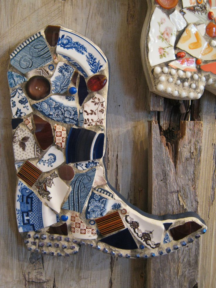 Mosaic cowboy boot in brown and blue.