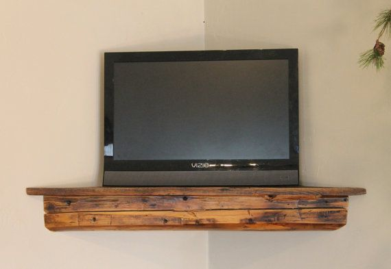 Corner floating shelf...great use of space, clean look, and still rustic with the reclaimed barn wood..(nix the tv though, I'd use it for other stuff)
