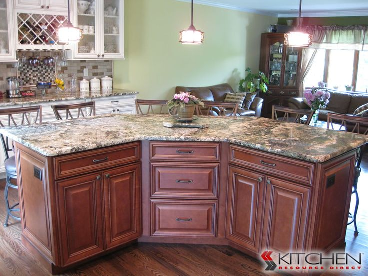 This kitchen island features plenty of storage on one side and seating