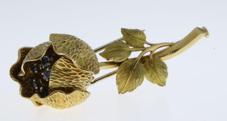 lot 585, An 18ct yellow gold gem set articulated floral bar brooch, gross. approx. 18 grams, est  £200-250