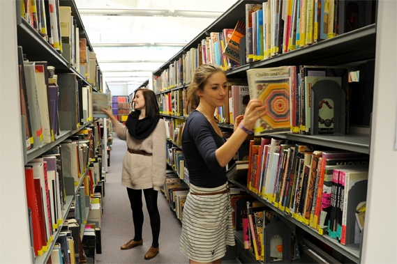 University Library at Epsom - Students selecting books.  #Epsom