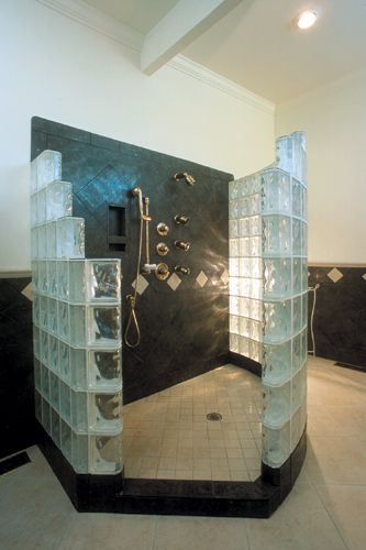 Walk-in, door-less Glass Block Shower constructed with a variety of sizes of Glass Block from Pittsburgh Corning in Decora pattern and finished with Endblock finishing units. The top of the Glass Blocks are capped with Stylecap glass tiles.