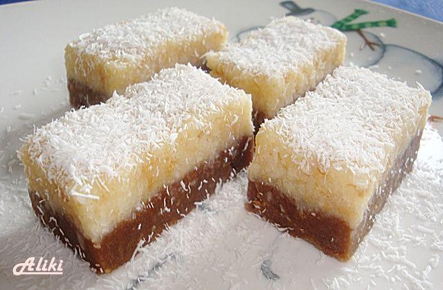 Μπαγιαδέρα    Υλικά    Για το μίγμα με κακάο και μπισκότα Petit    100 ml. γάλα  150 γρ. ζάχαρη  125 γρ. βούτυρο  1 φακελάκι βανίλια  1 κουτ. σούπας κακάο  300 γρ. αλεσμένα μπισκότα Petit    Για το μείγμα με ινδοκάρυδο  100 ml. γάλα  150 γρ.ζάχαρη  125 γρ. βούτυρο  1 φακελάκι βανίλια  200 γρ.ινδοκάρυδο  50