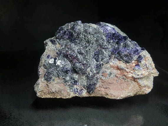 Interesting specimen of rich-purple fluorite in combination with red hematite on limestone from county Clare, The Burren, Ireland. This great specimen measures ca.9cm and weighs 275g, it was collected in September 2017.