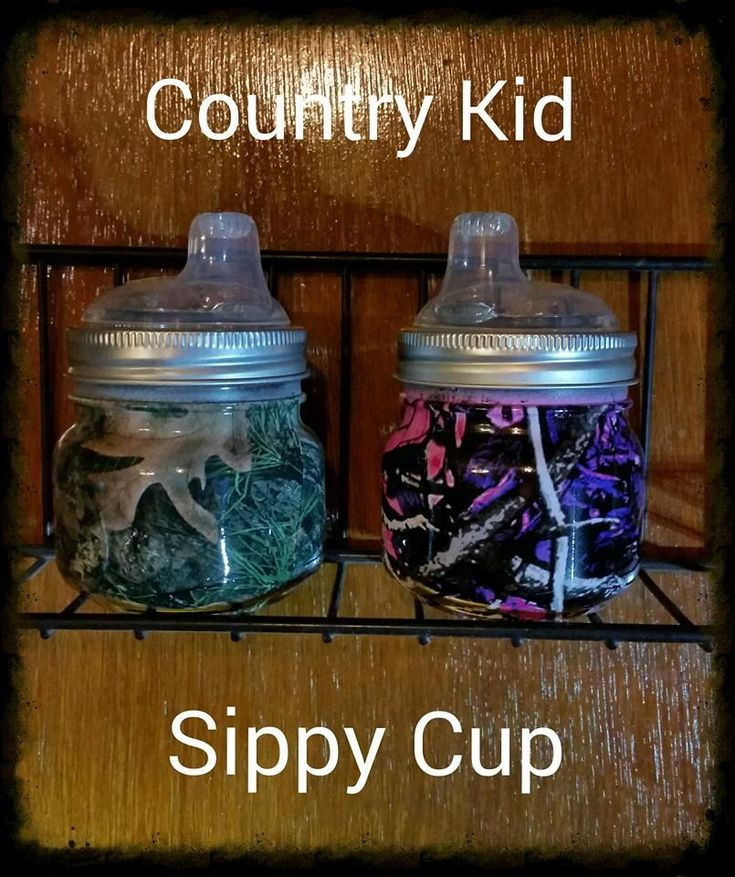 Country Kid Camo Sippy Cup. Made from a 8oz mason jar. Muddy girl and regular camo. Find these at https:// www.facebook.com/backwoodsjugsnmugs