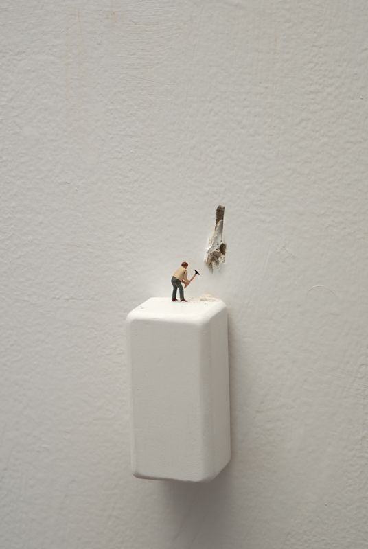 Liliana Porter, Man with Pickaxe (2009)  painted wooden base, dust, and figurine wall installation  3 ¾ x1 4 in. (object size)  Wall has to be broken and dust goes over wooden base.