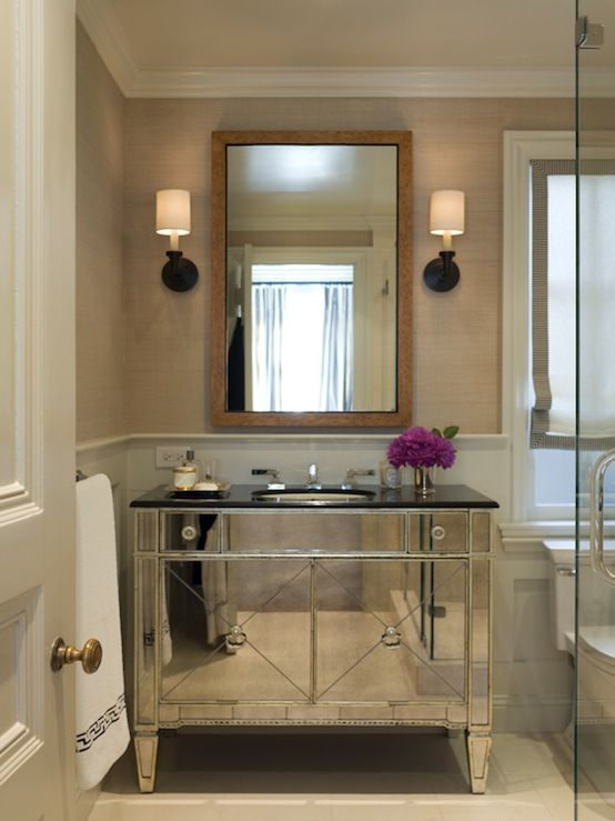 chic bathroom with borghese mirrored bathroom vanity with black marble top sand grasscloth wallpaper oilrubbed bronze sconces tortoise shell mirror