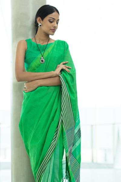 Lush green grass lands, with hills and dips, creating shadows over large fields was taken as its inspiration to create this cotton sari. Team with black silver jewellery for an ideal look