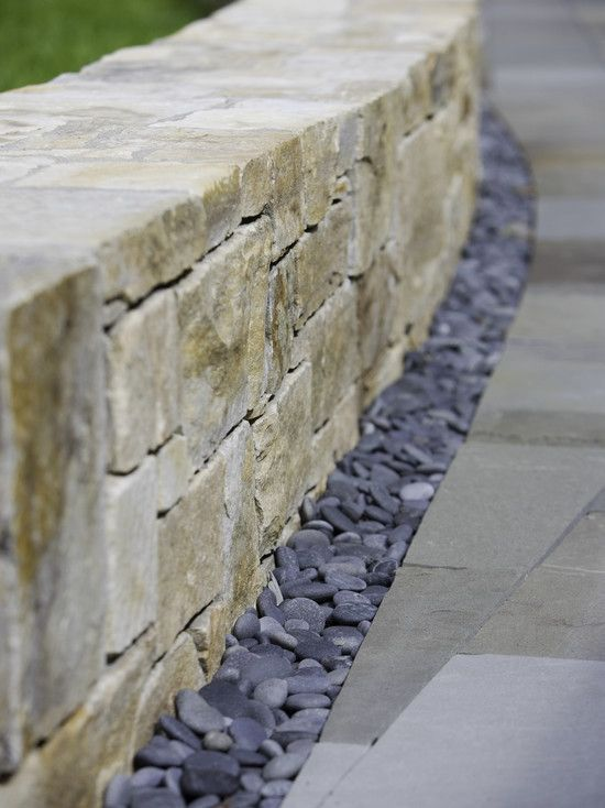 Who says you need plants to edge your fence or retaining wall?  River rock provides a beautiful natural element that is a perfect compliment to greenery...plus no need to water it!