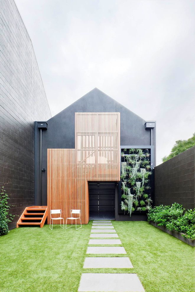 Vertical slatted timber exterior contemporary with white albert park white