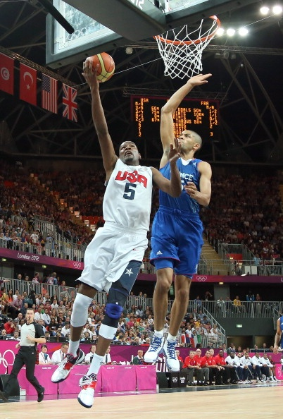 Kevin Durant #5 of United States against Nicolas Batum #5 of France during their Men's Basketball Game on Day 2 of the London 2012 Olympic Games at the Basketball Arena on July 29, 2012 in London, England.