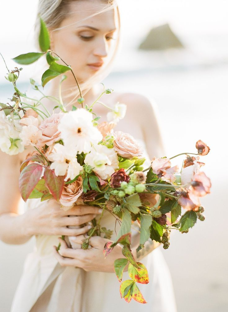 Closeup Shot Of Bride Holding Bouquet At Beach Planned By Honour