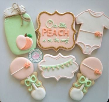 "Our Little Peach is on the way!This sweet baby shower theme is only made sweeter with these cookies!!Custom created cookies and carefully decorated will add that extra pizzaz to your sweets table. You can even use them as the perfect favor.Set comes with the following designs:-Mason Jar (4inches)-Square ""Our peach is on the way"" (4inches)-Baby Onesie (3inches)-Baby Rattle (3inches)-Fancy Rectangle with ""welcome"" (3inches)Each cookie come..."