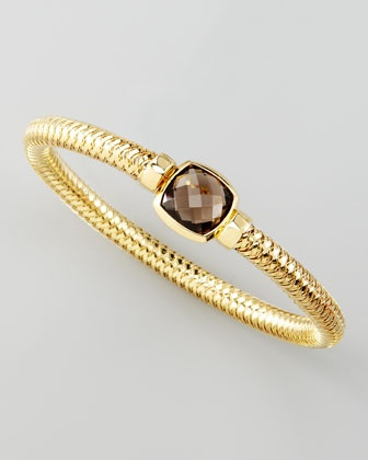 "Roberto Coin-USD: 1,700 Primavera Smoky Quartz Cushion Bangle From the Primavera Collection. 18-karat yellow gold. Cushion-cut smoky quartz. Intricately woven, stretch slip-on style. Roberto Coin signature hidden 0.3 carat ruby. 2 1/2"" diameter. Made in Italy."