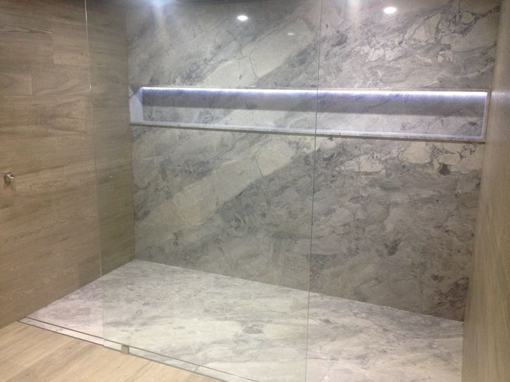 White Fantasy Quartzite shower floor and wall with Timber-look Porcelain tiles. ace Fortitude Valley. www.acestone.com.au