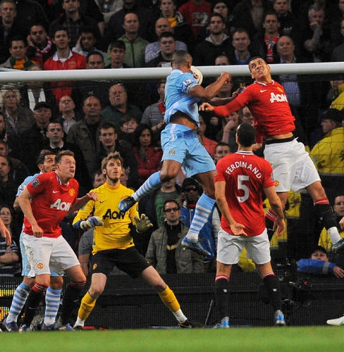 Manchester City's Vincent Kompany heads home the only goal of the match against Manchester United in Monday's derby.