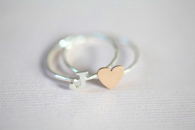 Secret love stackable rings - gold filled tiny heart ring with sterling silver initial ring  (Made to order). $35.00, via Etsy.