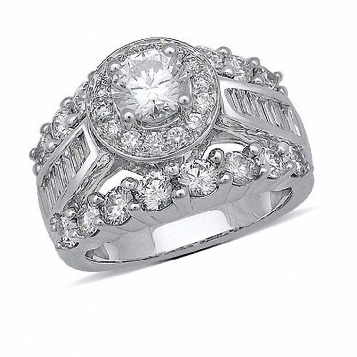 This 3-1/2 ct. t.w baguette and round diamond engagement ring is set in 14K white gold.