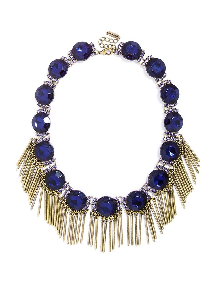 Multifaceted gemstones are embellished with slim, antiqued gold fringe for an edgy accent with a touch of Old World elegance.