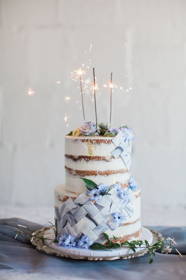 wedding cakes with sparklers - photo by Natalie Bray Photography http://ruffledblog.com/french-provencal-wedding-inspiration-with-geometric-accents