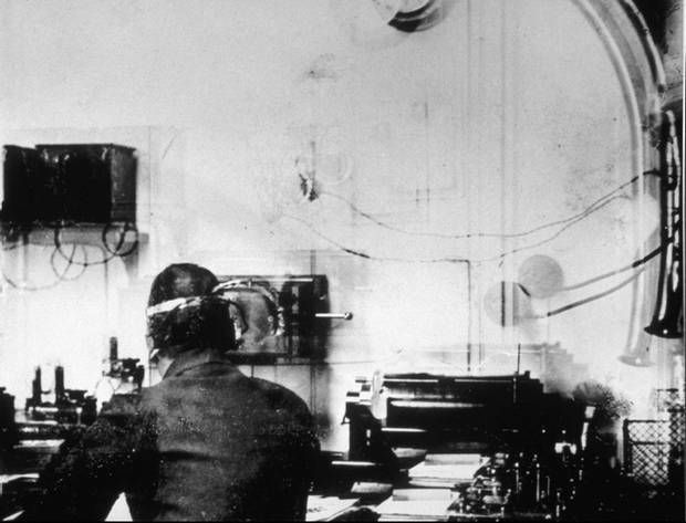 Marconi Room on RMS Titanic showing Harold Bride in a picture taken by Father Browne.