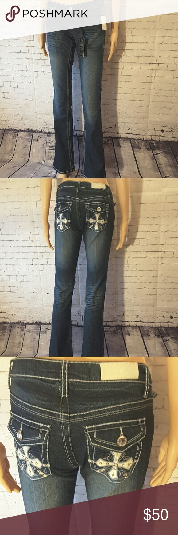 "🆕ZCO JEANS ZCO JEANS PREMIUM DENIM size 5 NWT it has beautiful back pocket details and a big bling front button, 14"" flat waist, 7"" rise,  31"" inseam ZCO Jeans"