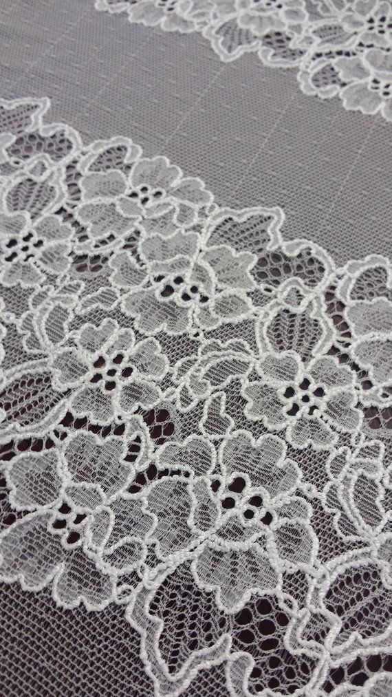 Off white lace fabric. Both sides scalloped. Width: 155 cm/61 inches Item number: L300414 Price is set for one meter/yard. You will receive the fabric in one continuous piece if you purchase more than 1 meter/yard. You can purchase a sample here:
