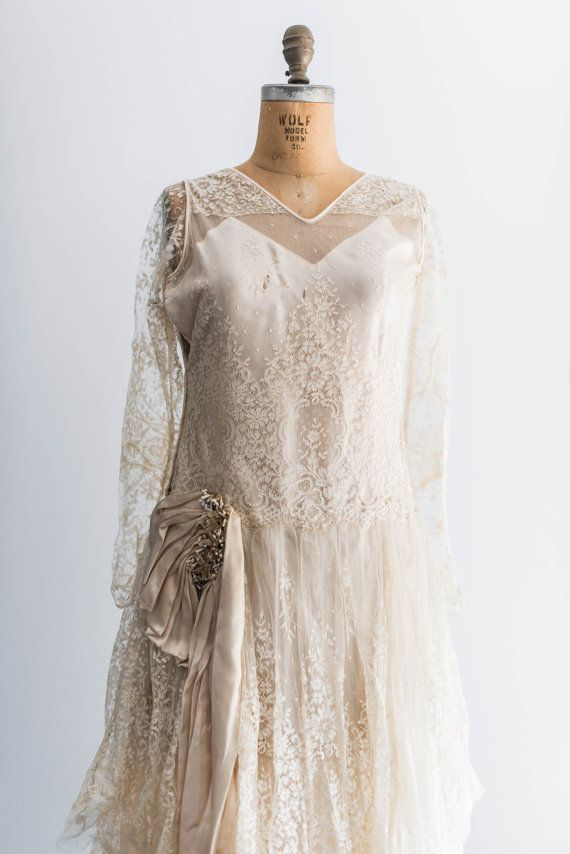 Breathtaking 1920 handmade wedding dress consisting of layers of silk tulle over silk charmeuse.