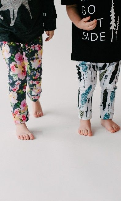 Our clothes play as hard as they do. These fun little leggings come in sizes to take your kid from brand new to school. We've got our rainbow bouquet, or feathered pattern, plus many more! Check 'em out in the store.  Photo by @jaymelang