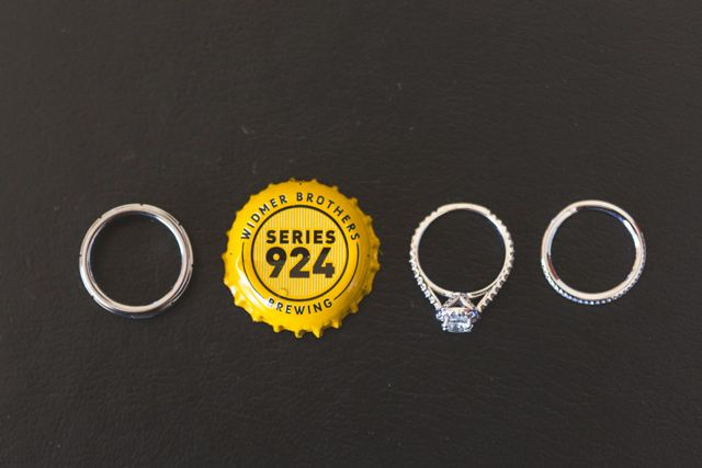 Ring photo (with a nod to the craft beer-loving groom) by cptphotography.com