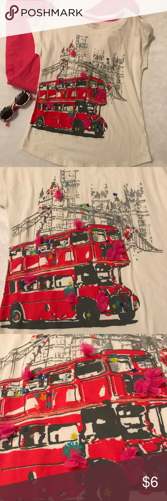 Girls sparkle tee Cherokee girls sparkle tee double decker London bus. 🚌 . Such a fun top for your sweet girl!! Size M in girls. Excellent condition and smoke free home ** pants for sale in another listing Cherokee Shirts & Tops Tees - Short Sleeve