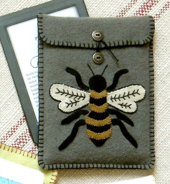 Wool Kindle cover -- Bee Butterfly pattern by Black Mountain Needleworks.