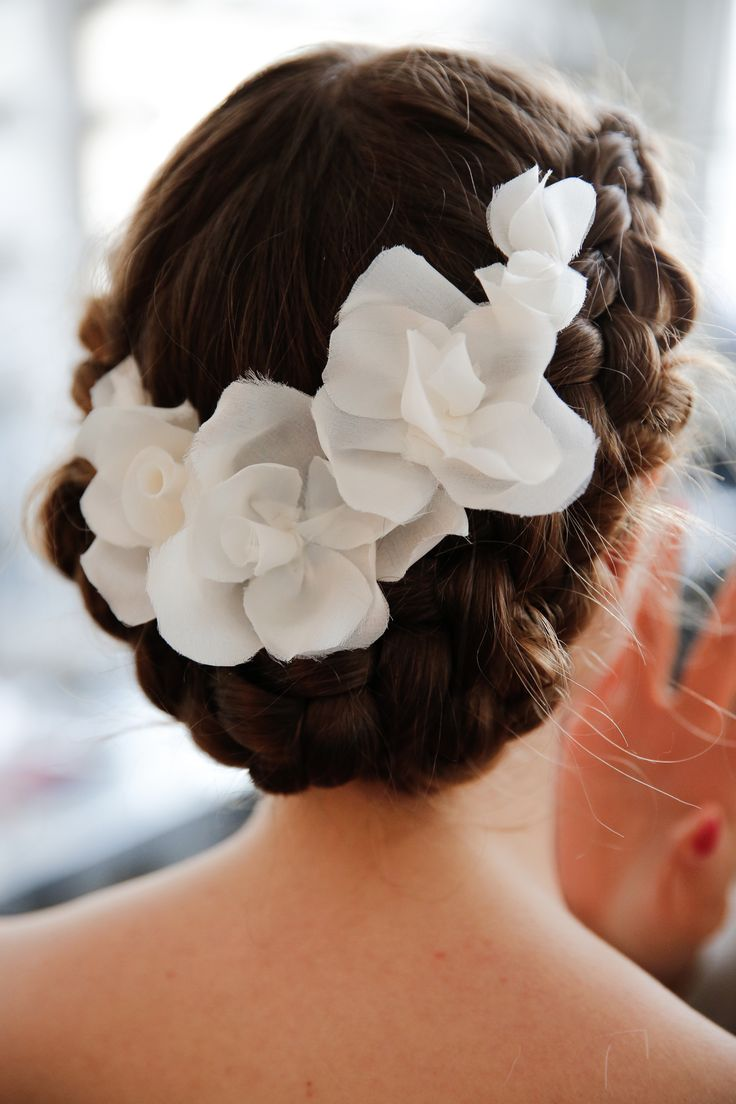 A floral halo doesn't have to rest on top of your head.  Secure your headpiece along the back for a modern twist!   image via Marchesa