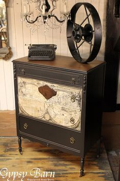 Dresser modification from drawers to door, tea stain, ink transfer, and a beutiful finish.