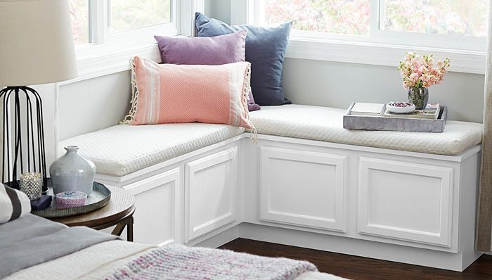 Corner Bench - Use stock cabinets to build a simple DIY window seat and transform any corner into a cozy bedroom or living room nook.