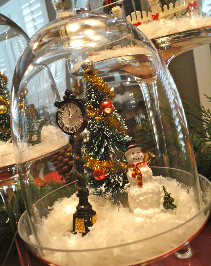 Christmas Cloche Display - Use those cloches to set up little holiday scenes including snow, which won't end up all over your house when kept under a lid!
