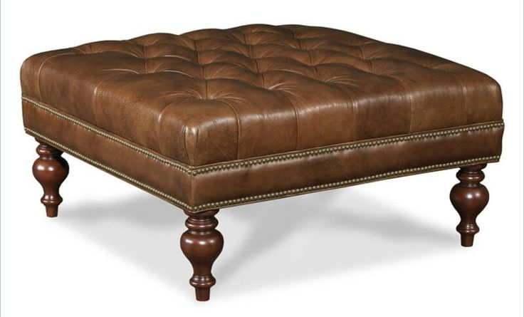 Here's a second Hooker Furniture offering, featuring button tufted leather cushion with familiar nail head trim and arrow feet.