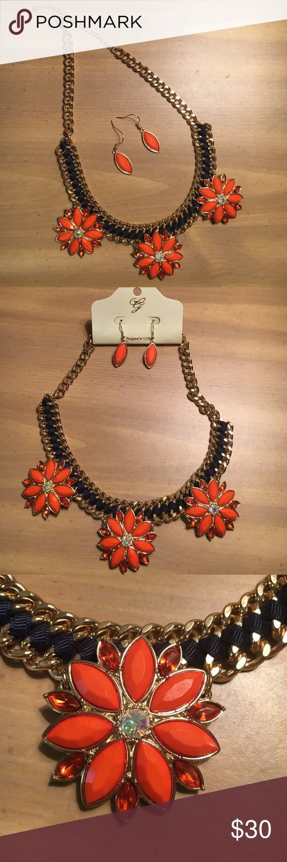 NWT flower statement necklace with earrings This gorgeous statement necklace and earring set has never been worn except to take the picture of the necklace on! Necklace: Gold chain with navy blue fabric braiding and 3 orange jeweled flowers. Earrings: orange stone surrounded by gold lining. Lead & nickel compliant. Great for Auburn football or sorority recruitment! Jewelry Necklaces