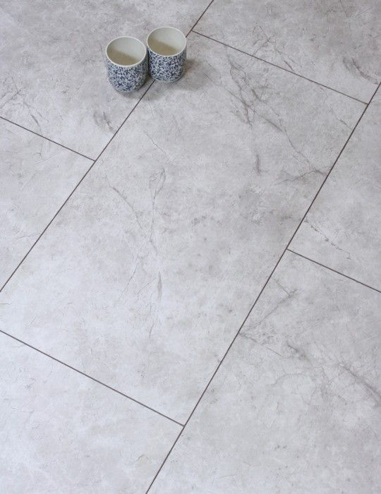 The magma white tile by german manufacturers egger is a for Grey bathroom laminate flooring
