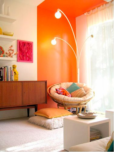 I love the idea of using just a strip of color around the window.  An entire room in that color would be too much but the sun light will reflect off the orange and give the whole room warmth.