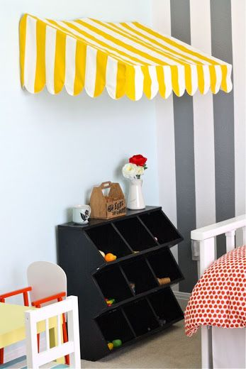How fun is this awning for a playroom? All the details you need to make it here.