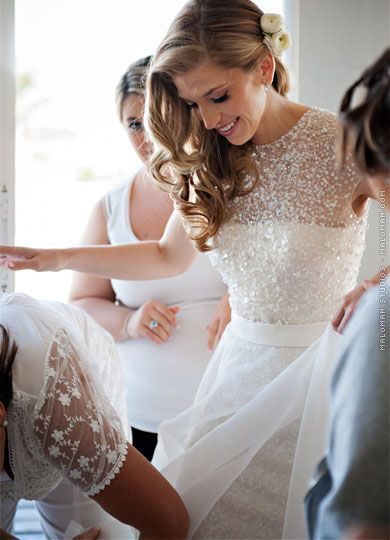 Sparkles meet a gorgeous wedding dress in incredible fashion. Throw in gorgeous curly hair and you have the best wedding combination