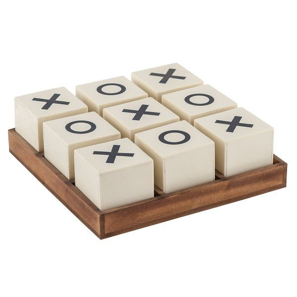 Offered by historians as a secret lynchpin factor in the collapse of the roman empire, the ancient pastime of noughts and crosses presents 362,880 possible outcomes. Sterling Industries Crossnought Tic-Tac-Toe Game is elegantly styled and perfect for teaching good sportsmanship to fierce competitors and favorite nephews. Handsome chestnut-toned wood frame.